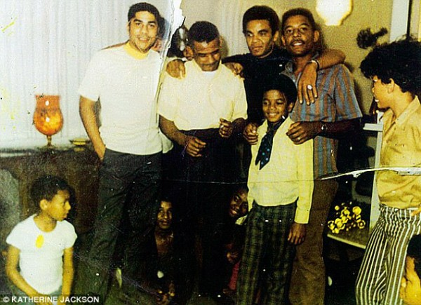 Michael with the Jackson clan (father Joe is in the black top)